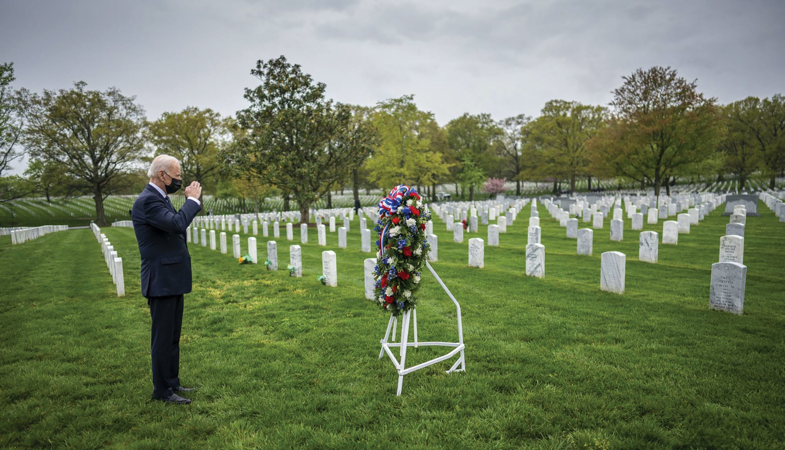 President Joe Biden salutes during a visit to Section 60